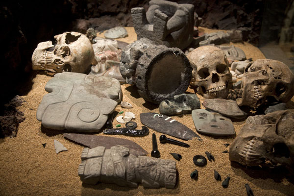 Picture of Skulls, jewelry, and small statues were among the objects found in graves