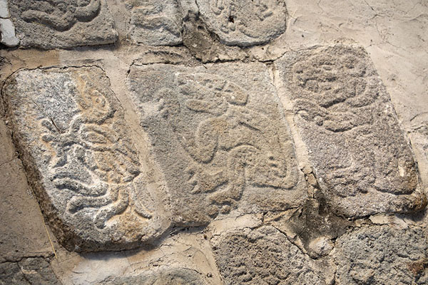 Foto de Close-up of some of the slabs of stone with carved animals in the animal rampXochicalco - Mexico