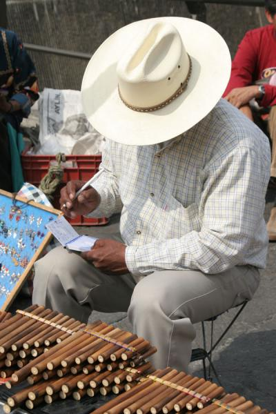 Picture of Zocalo, Mexico City: street seller of panflutes - Mexico - Americas