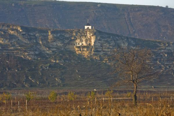 Picture of The cliffs of Pestera Hermitage with the belfry aboveOrheiul Vechi - Moldova