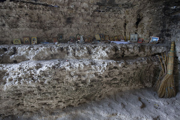 Row of religious images in a rock cave in Tipova Monastery | Tipova Monastery | Moldova