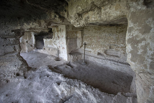 Monastic cells hewn out in the rockface of Tipova Monastery | Tipova Monastery | Moldova