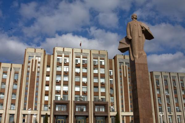 Picture of Lenin standing proudly on his socket in front of parliament buildingTiraspol - Moldova