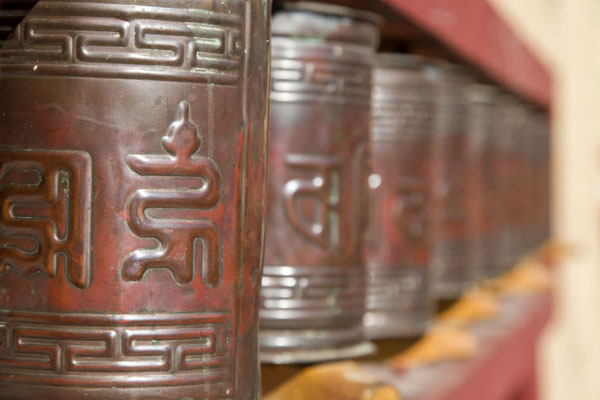Row of prayer wheels outside the main monastery | Amarbayasgalant Khiid | Mongolia