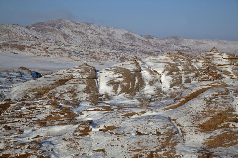 Picture of Mongolia (Rocks and mountains covered in snow in the early morning)