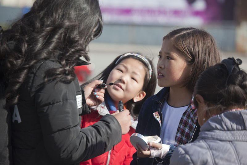 Girls getting make-up class at Chinggis Khaan square | Piazza Genghis Khan | Mongolia