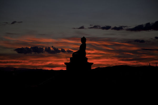 Sunset over a Buddha statue at the Danzandarjaa Khiid at the western part of Mörön | Mörön | Mongolia