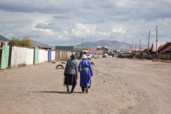 Two Mongolian women walking a street of Mörön | Mörön | Mongolia