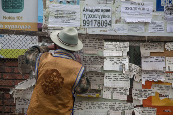 Mongolian man managing a message board at the market of Mörön | Mörön | Mongolia