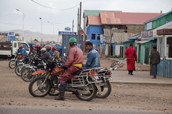 Motorbike riders waiting for customers at a corner in Mörön | Mörön | Mongolia