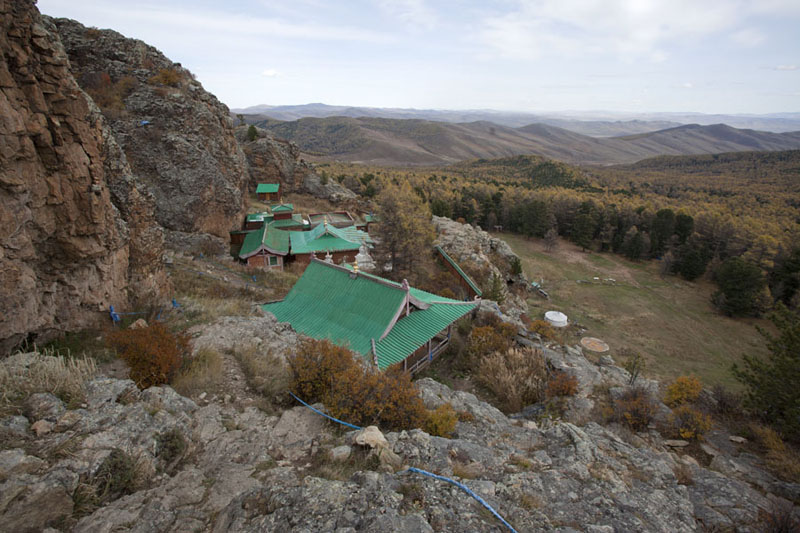 Picture of Tövkhön Khiid (Mongolia): The buildings of Tövkhön monastery with forested landscape in the background