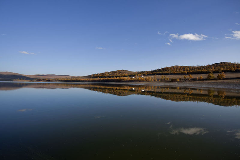 Perfect mirror of the mountains and trees surrounding Zuum Nuur | Zuum Nuur | Mongolia
