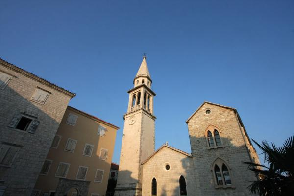 Late afternoon light with church and buildings of Budva |  |