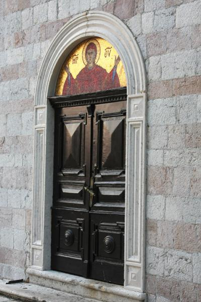 Foto van Late afternoon light on the side door of the church of the Holy TrinityBudva - Montenegro