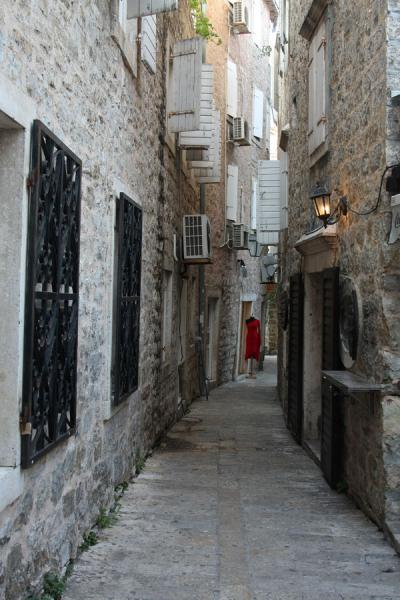 Picture of Budva Old Town (Montenegro): Old town alley with red dress