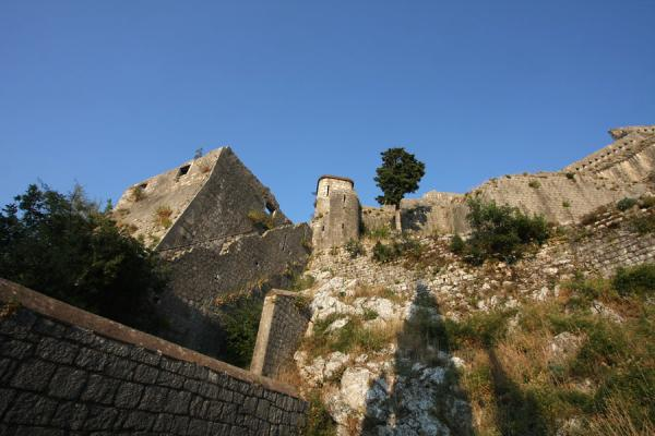 Late afternoon sunlight over part of the fortifications of Kotor | Kotor fortress | Montenegro