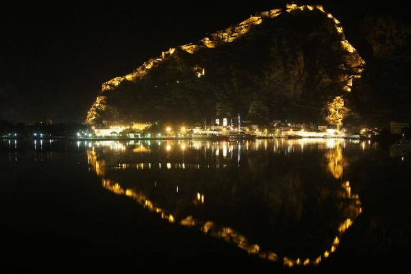 Lights of the fortress and town of Kotor reflected in the Bay of Kotor | Kotor fortress | Montenegro