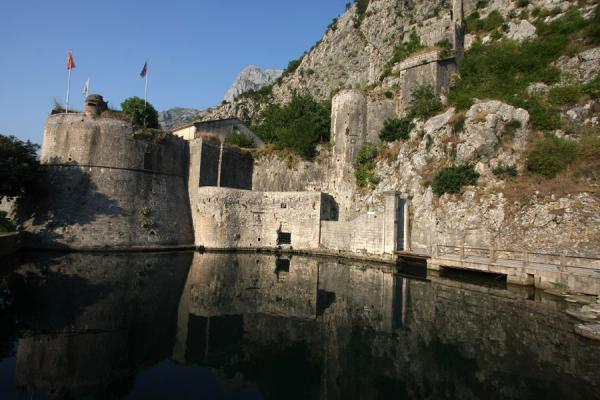 Picture of City walls reflected in the Gurdic spring, a small pond near the North Gate