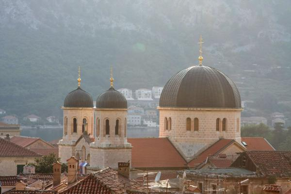 Picture of Church of St Nicholas high above the roofs of houses of the old town of Kotor