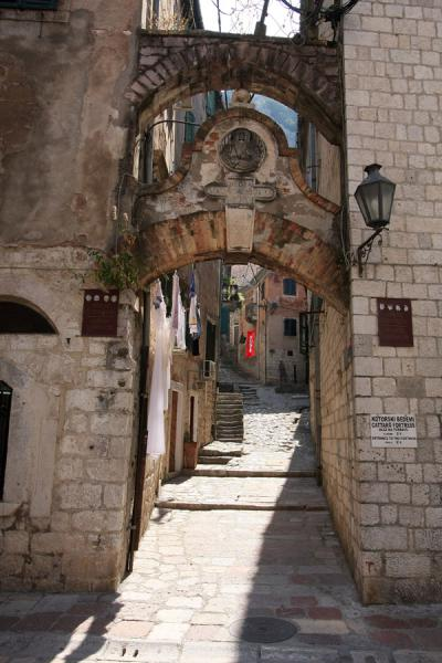 Narrow street leading to the main entrance to Kotor fortress | Kotor Old Town | Montenegro