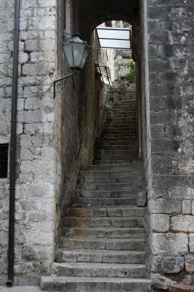 On the eastern side of Kotor, steep stairs lead up to houses higher up the hill | Kotor Old Town | Montenegro