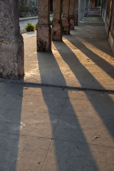 Pillars casting shadows on the walkway in Ibo | Ibo | Mozambique
