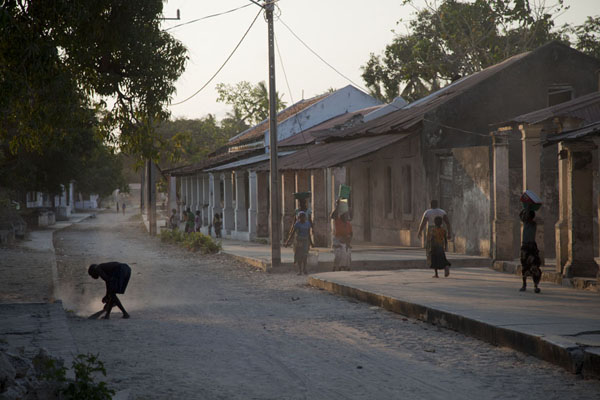 Man cleaning a dusty street of Ibo in the afternoon | Ibo | Mozambique