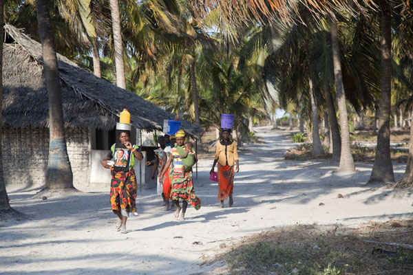 Womn walking the sandy track on Matemo island | Matemo Island | Mozambique
