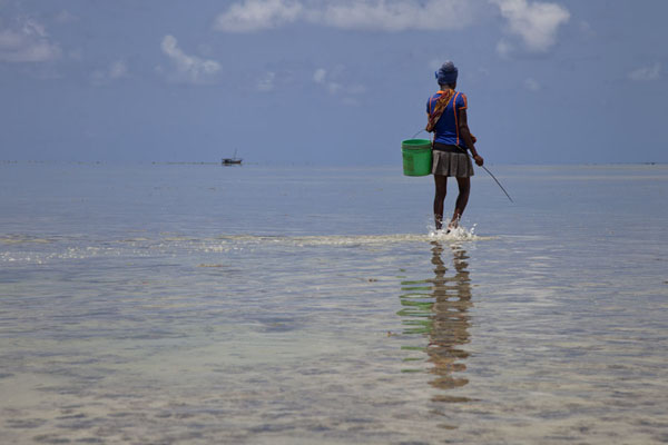 One of the girls on a hunt in the shallow waters off Ibo | Mujaca Lighthouse Walk | Mozambique