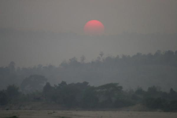 Sun setting over the riverine landscape seen from the boat  | Ayeyarwady Boat | Myanmar (Burma)