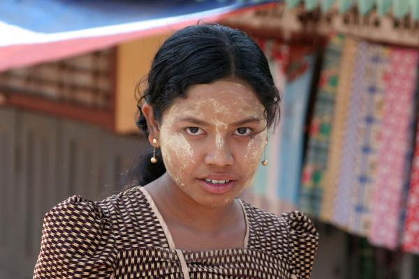 Picture of Burmese girl with tanakha on the market of Pathein