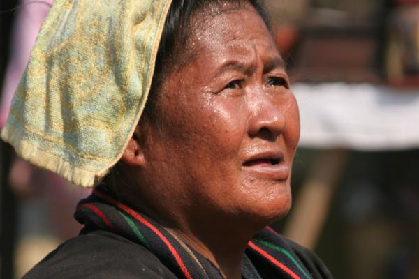 Picture of Burmese market woman talking to her customer on the shore of Inle Lake