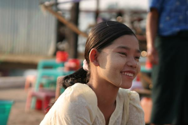 Picture of Burmese smile on the face of a young girl on a street market