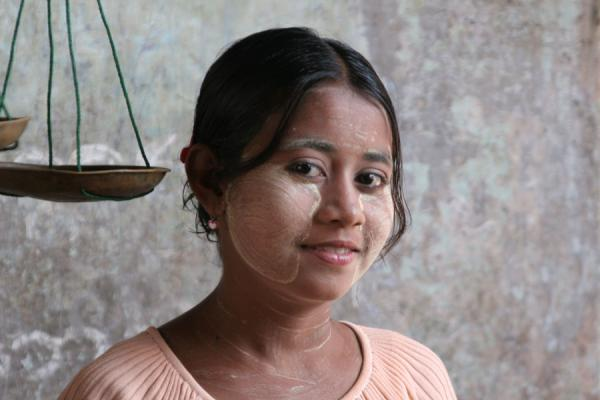 Picture of Burmese faces (Myanmar (Burma)): Burmese girl with subtle smile in her shop