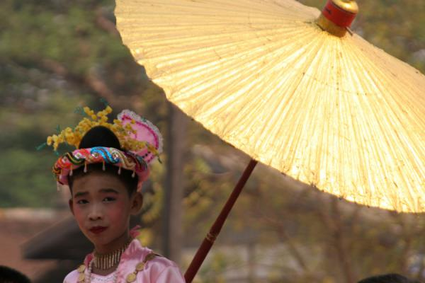Burmese girl with a golden parasol in a procession | Burmese faces | Myanmar (Burma)