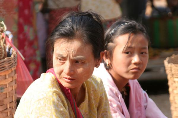 Picture of Burmese woman with girl waiting for customers at a street market