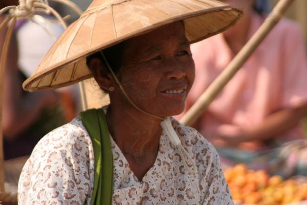 Woman with typical hat at a street market | Burmese faces | Myanmar (Burma)