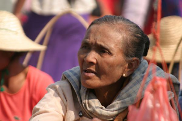 Picture of Burmese faces (Myanmar (Burma)): Old Burmese woman shopping in the streets