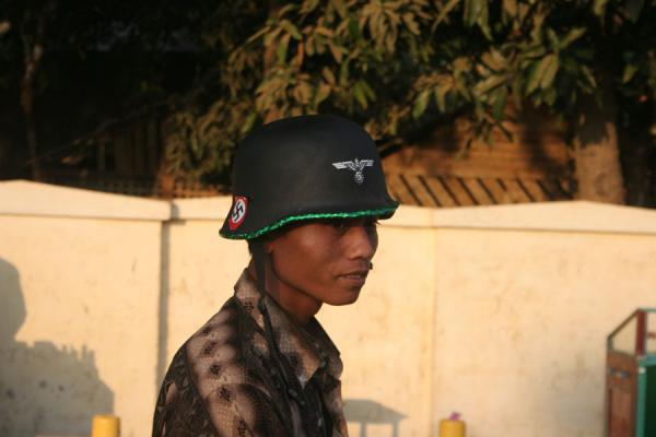 Guy wearing a helmet with German World War II symbols | Burmese helmets | Myanmar (Burma)