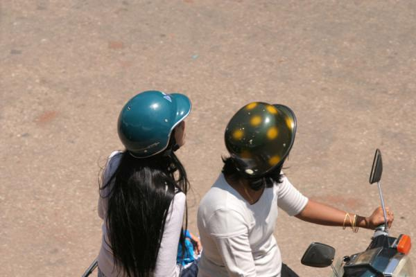 Picture of Burmese helmets (Myanmar (Burma)): Fancy coloured helmets in the streets of Pathein