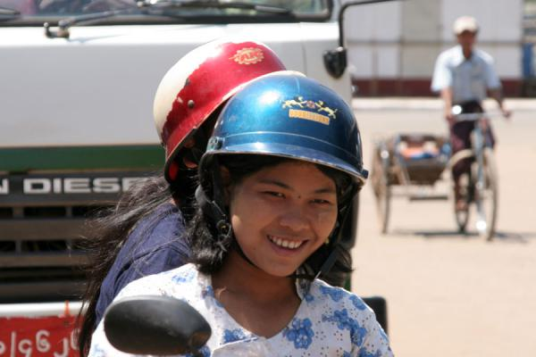 Young girls on a motorcycle with their helmets | Burmese helmets | Myanmar (Burma)