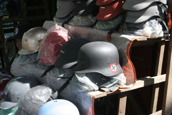 Stall with helmets, with a collection of German nazi helmets | Burmese helmets | Myanmar (Burma)