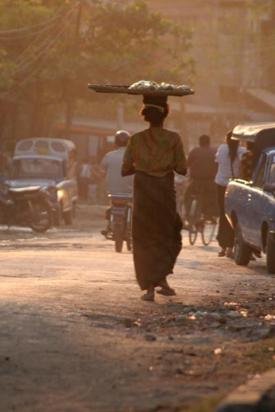 Picture of Burmese public life (Myanmar (Burma)): Burmese woman walking the streets of Mandalay towards sunset
