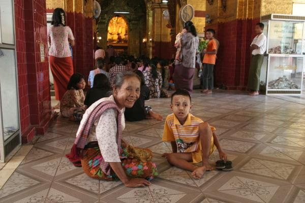 Picture of Burmese public life (Myanmar (Burma)): Buddhist worshipper and boy praying at Mahamuni Paya
