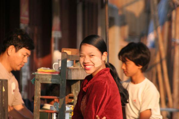 Picture of Burmese public life (Myanmar (Burma)): Sunny smile of Burmese girl in the streets of Katha