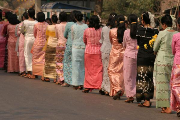 Picture of Burmese public life (Myanmar (Burma)): Colourful procession with elegantly dressed women in Bagan