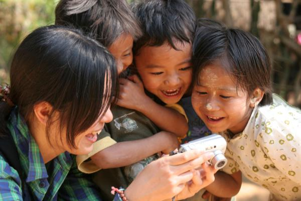 Picture of Burmese children looking at their picture on a Japanese digital camera