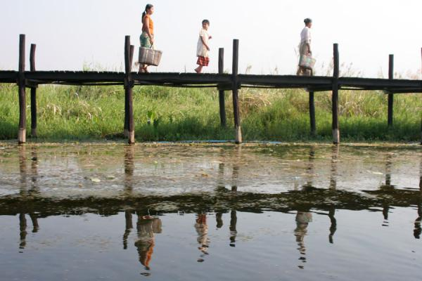 Reflected in the waters of a canal: walking on a bridge near Inle Lake | Inle Lake | Myanmar (Birmanie)