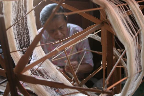 Picture of Old Burmese woman working in one of the many workshops on Inle Lake