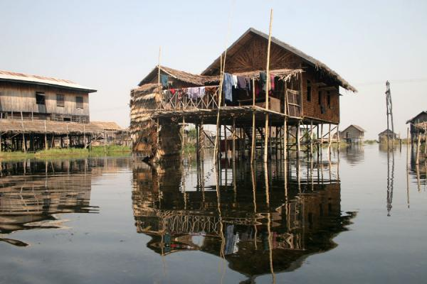 Picture of Traditional Intha houses on stilts reflected in the canals of Inle Lake - Myanmar (Burma) - Asia